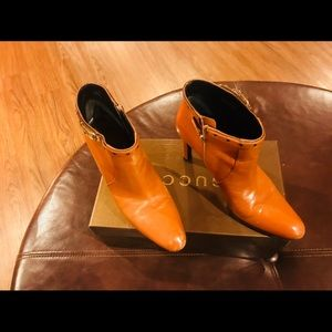 Authentic Gucci boots with gold buckle accent